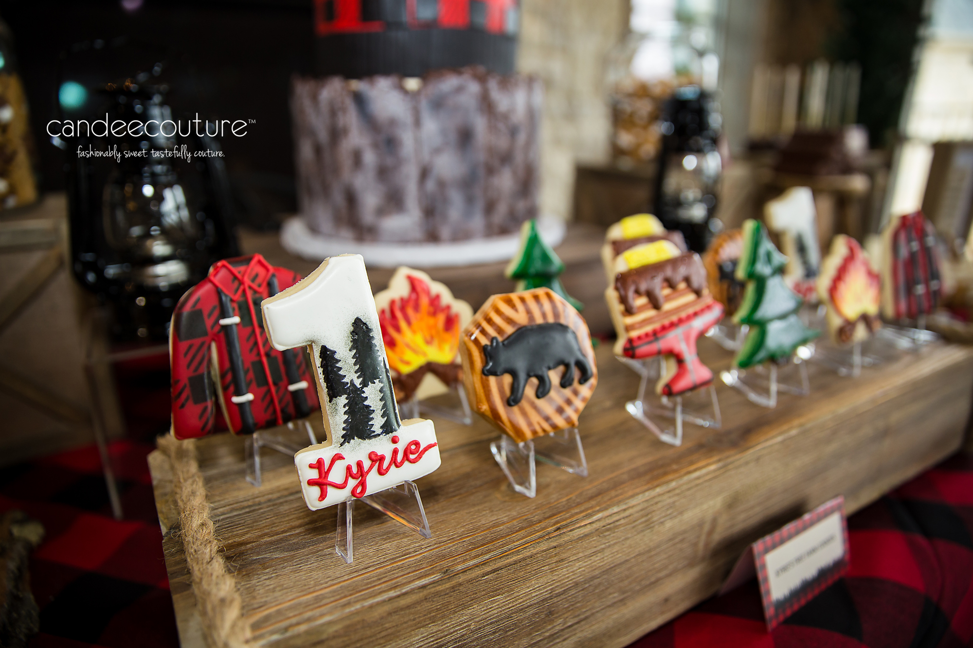 Lumberjack cookies, cookies, custom cookies, camping cookies, campfire cookie, bear cookies, outdoor cookies, buffalo plaid, lumberjack campfire birthday party, birthday, party, party ideas, lumberjack cookies, smores cake pops, lumberjack dessert, cake, flapjacks